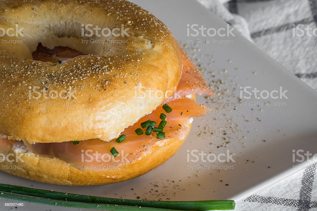with a smoked salmon bagel and cream cheese stock photo
