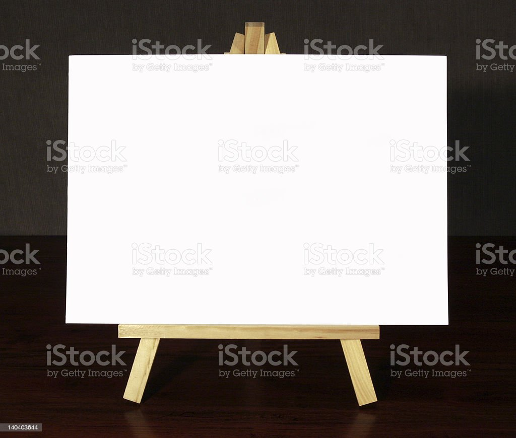 With canvas on a table easel on dark wood surface royalty-free stock photo