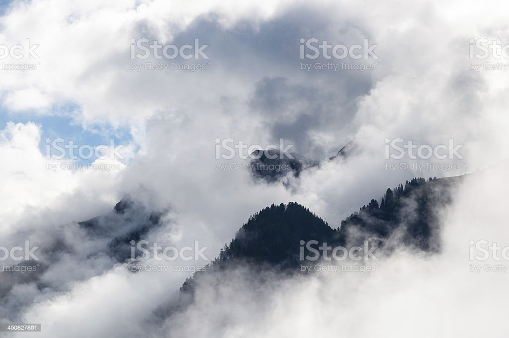 With clouds enveloped mountains in the Alps, Austria stock photo