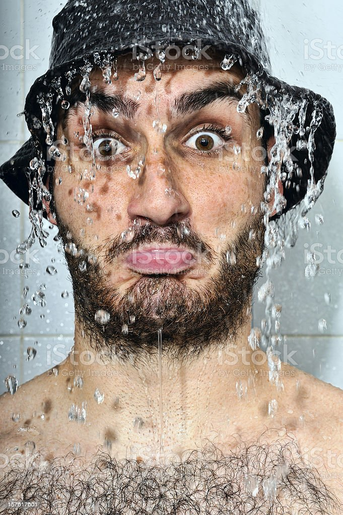 With hat under the shower royalty-free stock photo