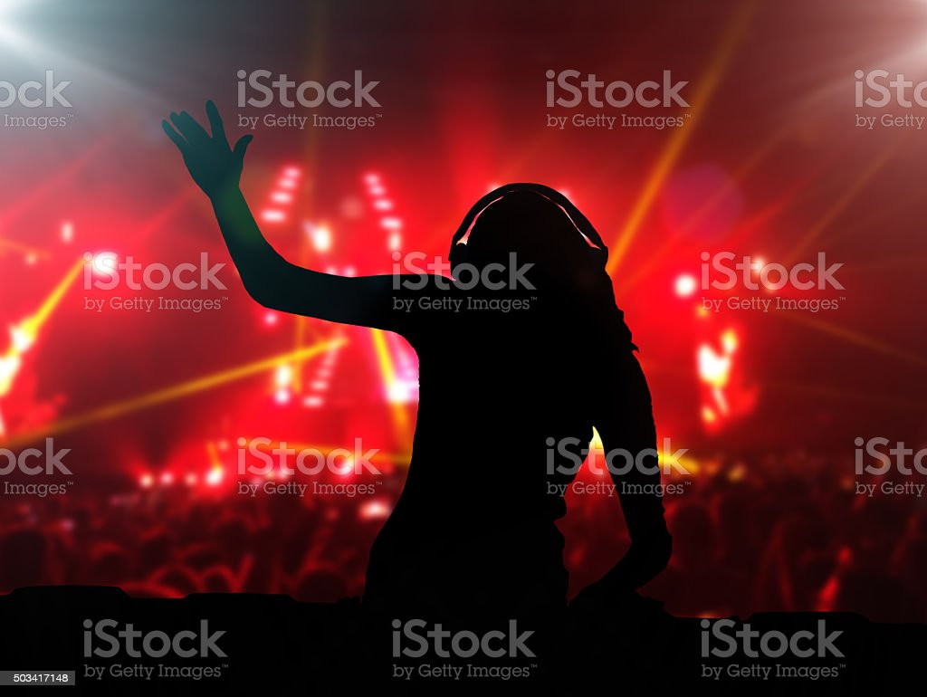 DJ with headphones at night club party stock photo