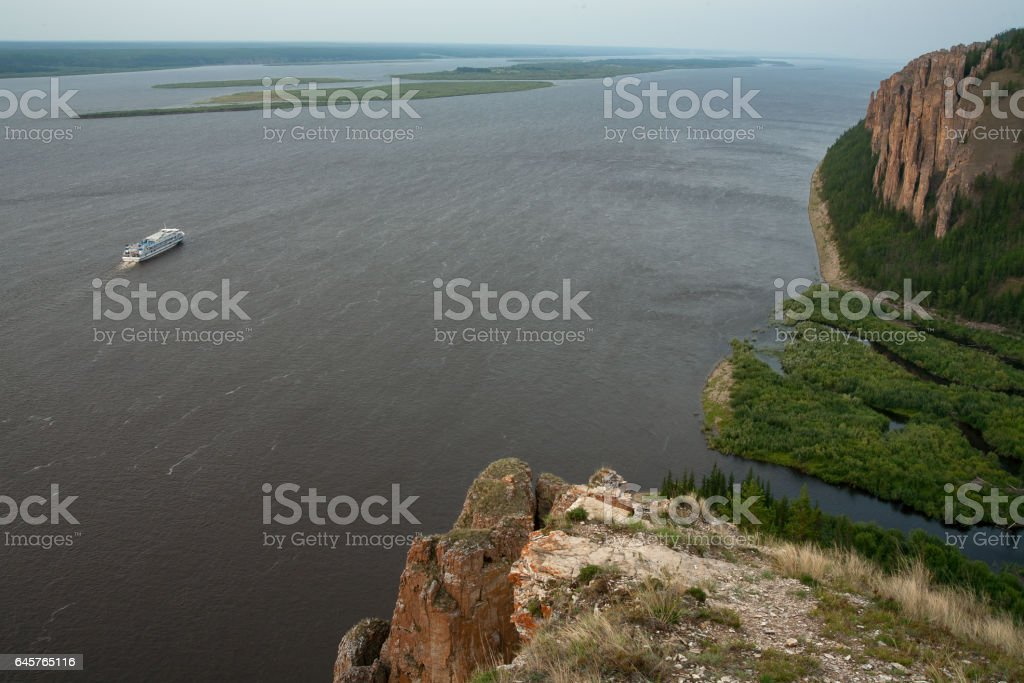 With high and rocky shores on the big river. stock photo