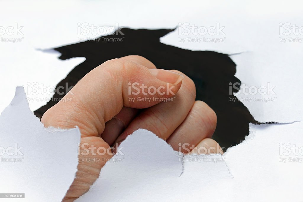 With his fist through the wall stock photo