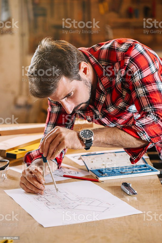 With men it's all about getting the measurements right royalty-free stock photo
