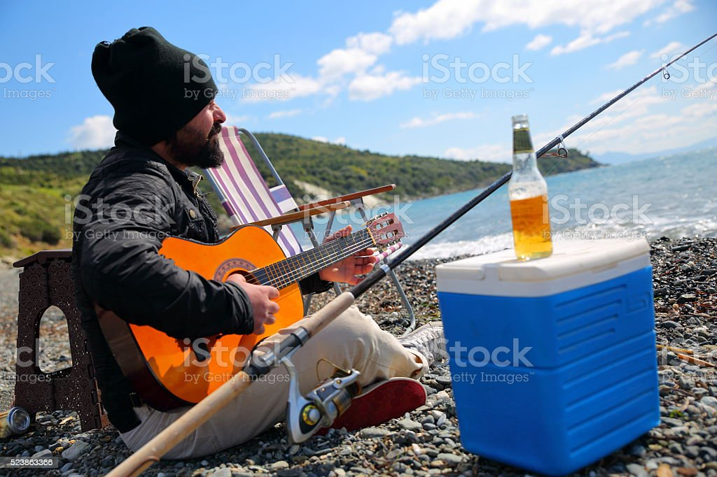 with music on fishing stock photo