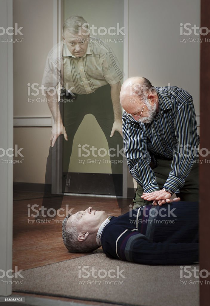 CPR with soul of victim in the afterlife stock photo