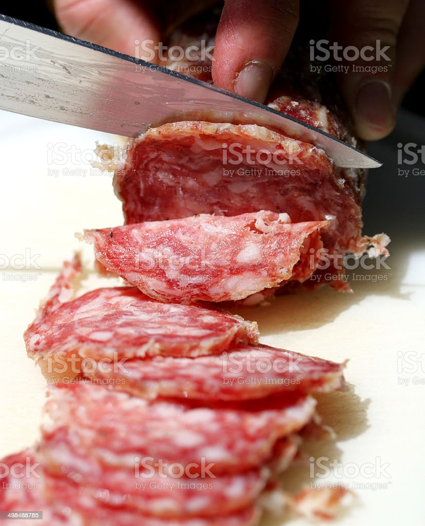 SALAMI with steel knife royalty-free stock photo