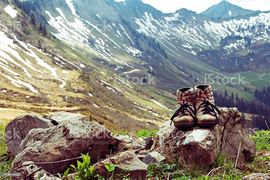 with the mountain boots in the mountains stock photo