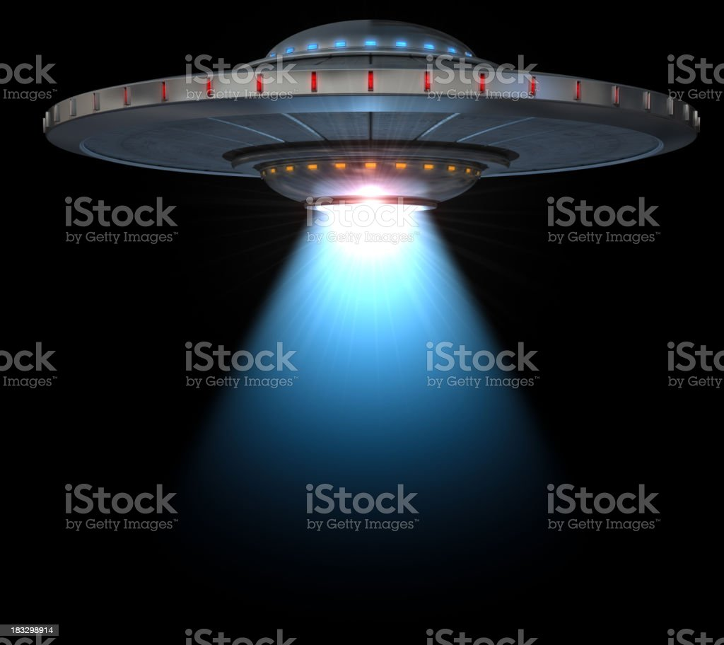 UFO with tractor beam stock photo