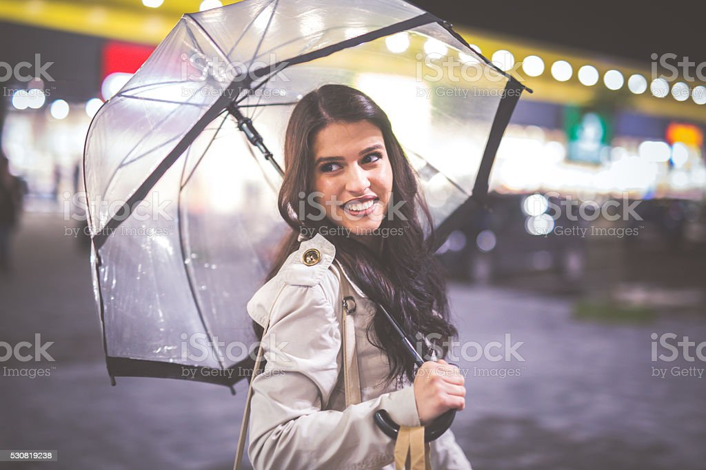 With umbrella in hand stock photo