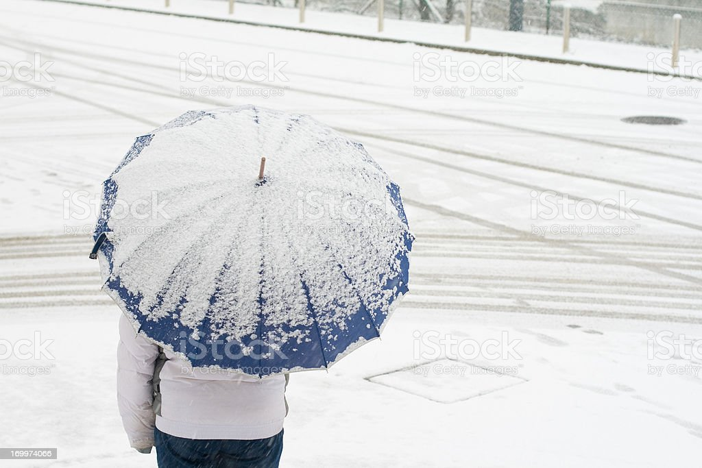 With umbrella in snow royalty-free stock photo