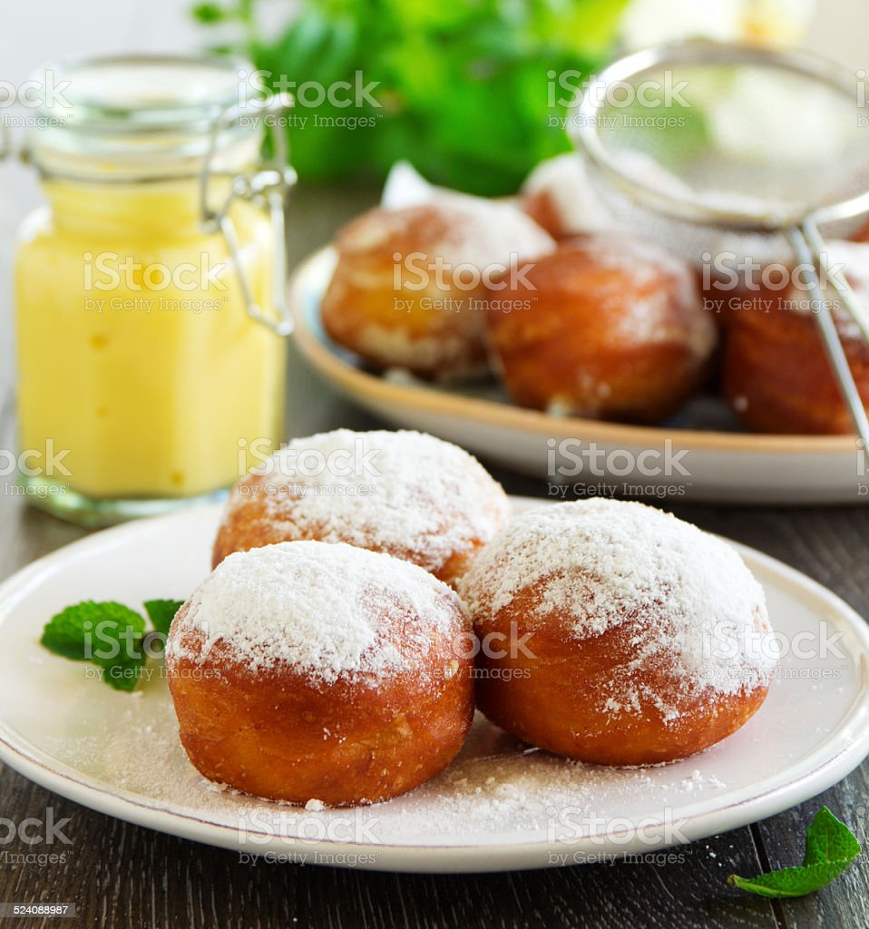 With vanilla cream donuts in powdered sugar. stock photo
