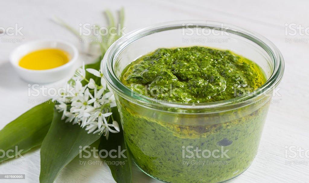 With wild garlic pesto in a glass stock photo