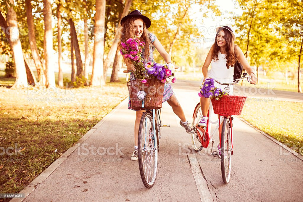 With you is always funny. A Bicycle Ride along park stock photo