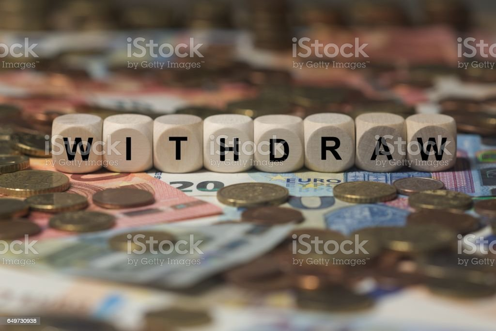 withdraw - cube with letters, money sector terms - sign with wooden cubes stock photo