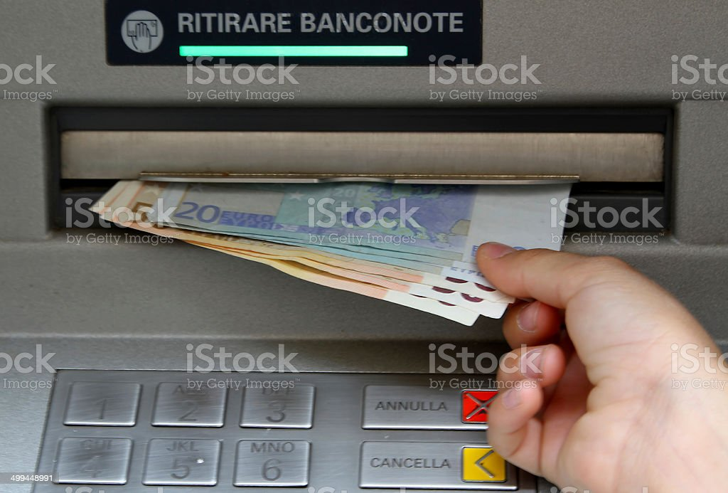 Withdraw money in banknotes from an ATM stock photo