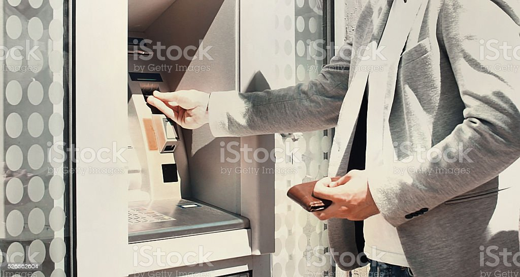 Withdrawing money at an ATM. stock photo