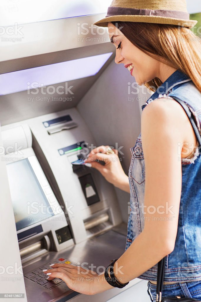 Withdrawing money from ATM. stock photo