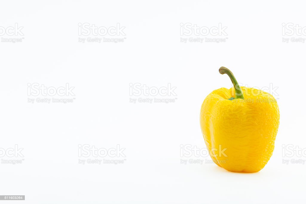 Wither yellow pepper, isolated on white. stock photo