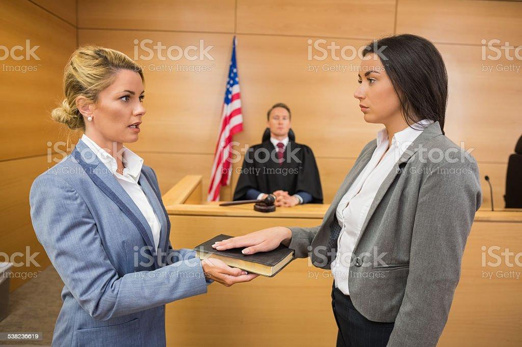 Witness taking an oath stock photo