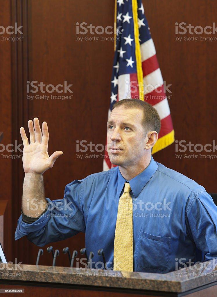 Witness taking oath in a trial stock photo