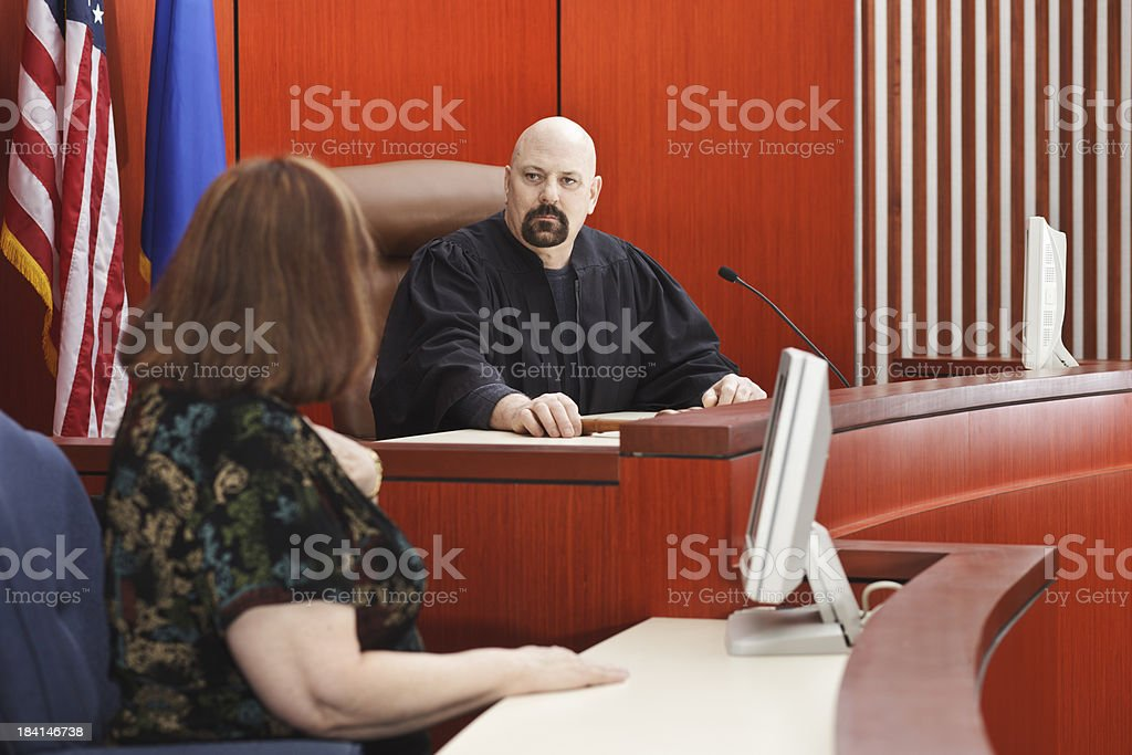 Witness with Judge Seated in Courtroom stock photo