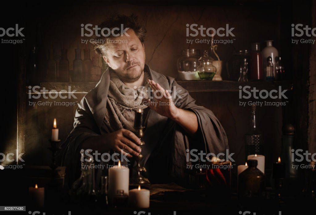 wizard brews a potion stock photo
