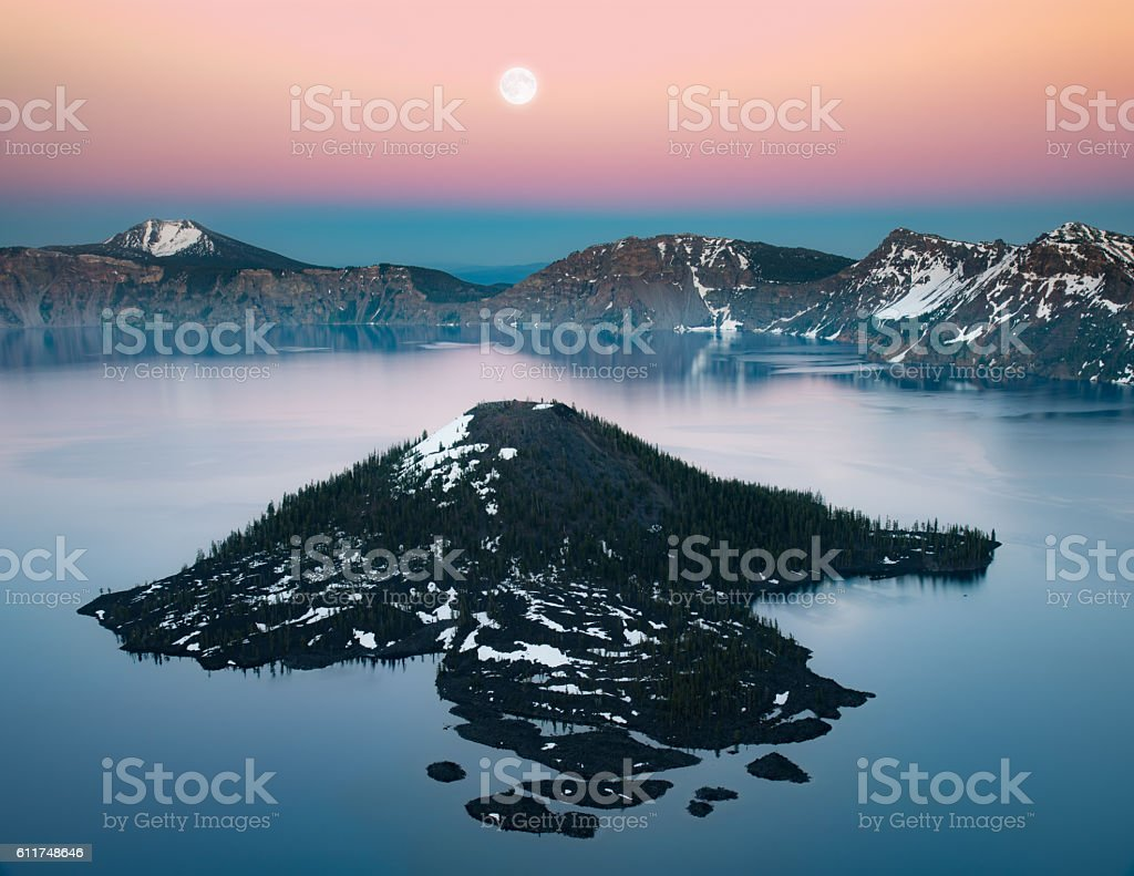 Wizard island and full moon stock photo