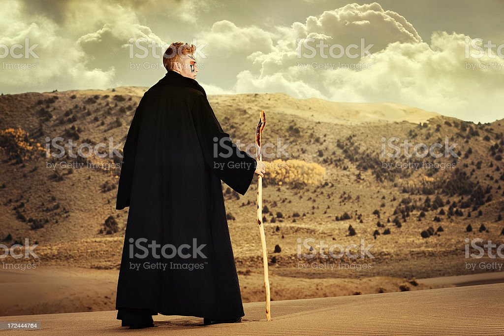 Wizzard Looking Out Across His Desert Domain royalty-free stock photo