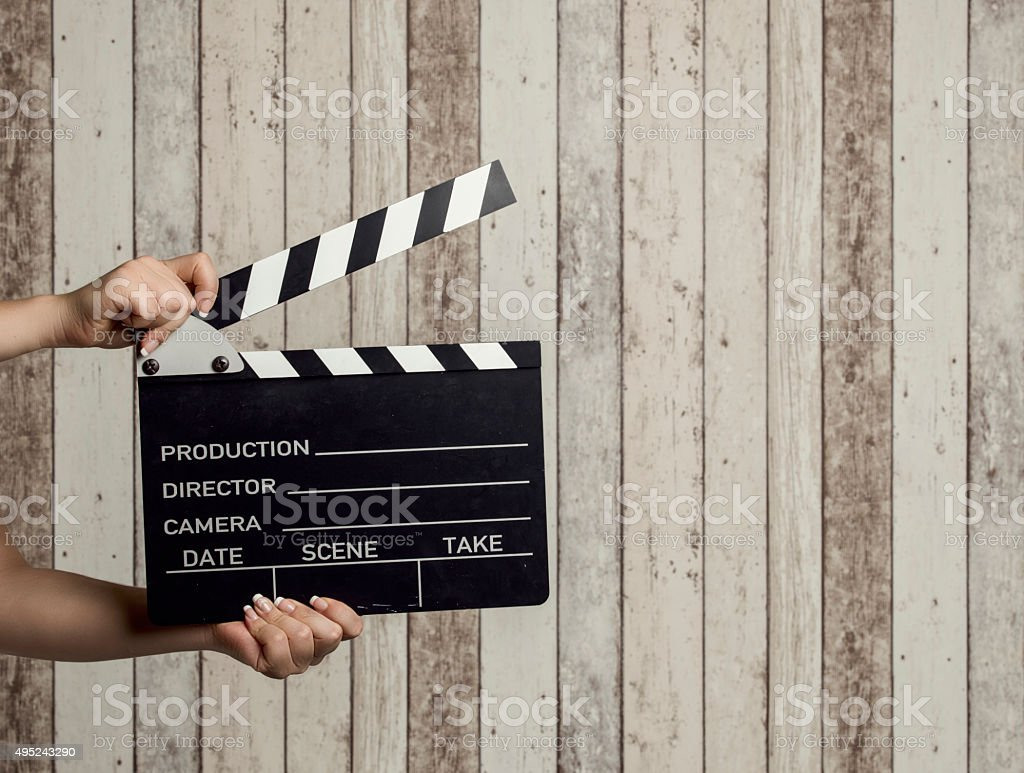 Wman holding a movie clapboard stock photo