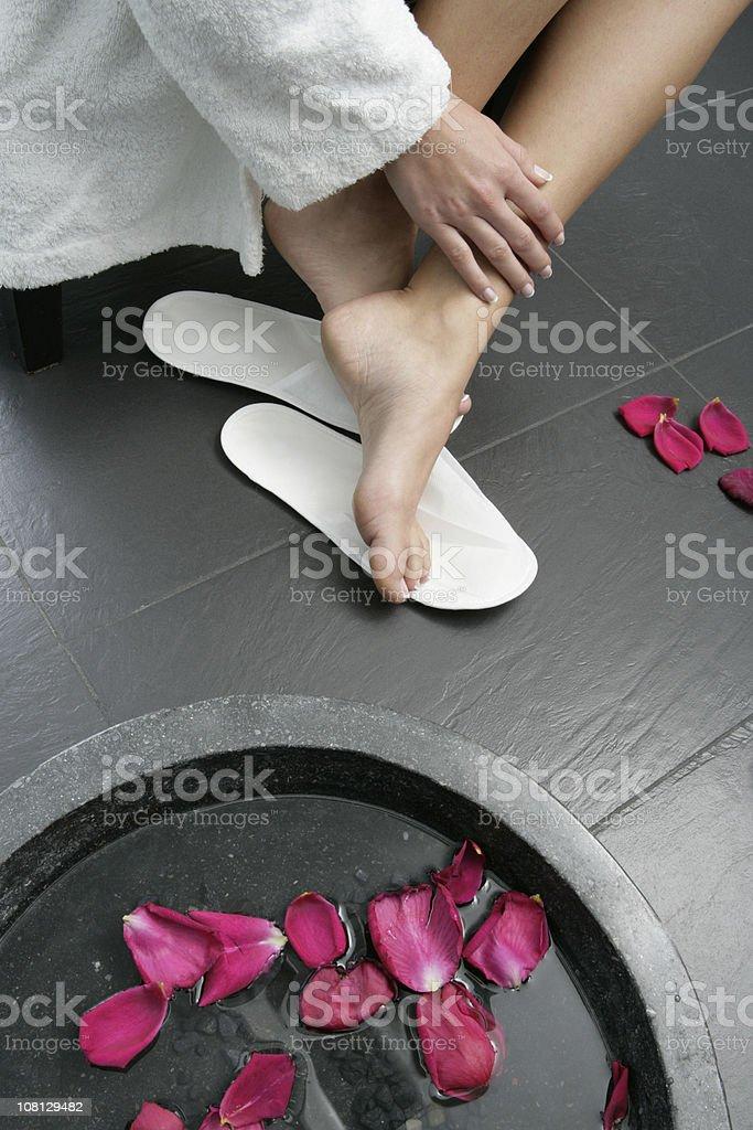 Wman's Feet in Spa Sandals Near Aromatherapy Bath royalty-free stock photo