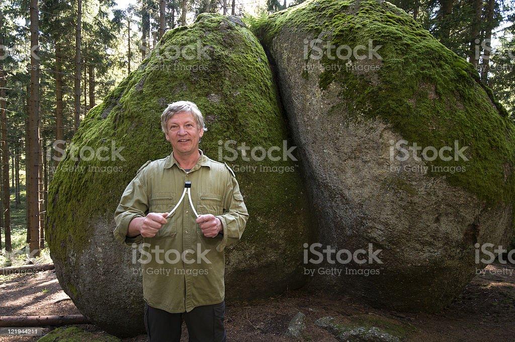 Wünschelrutengänger vor mystischen Felsformationen im Waldviertel royalty-free stock photo