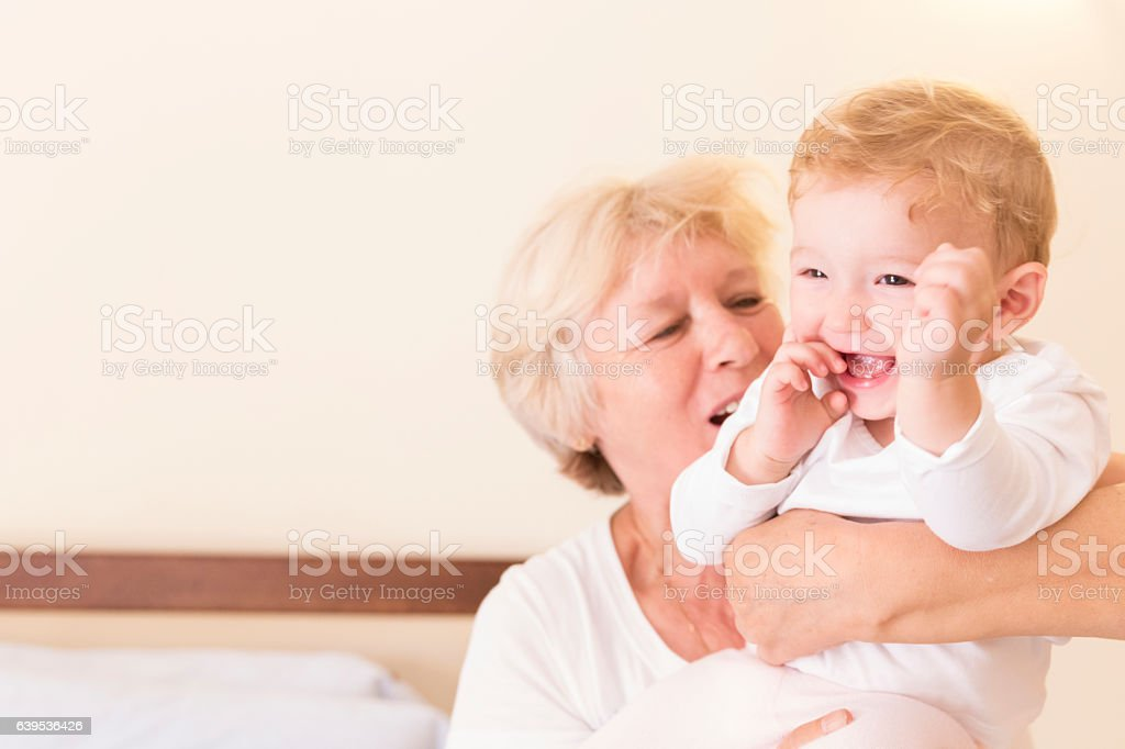 Woah there little one, settle down for grandma! stock photo
