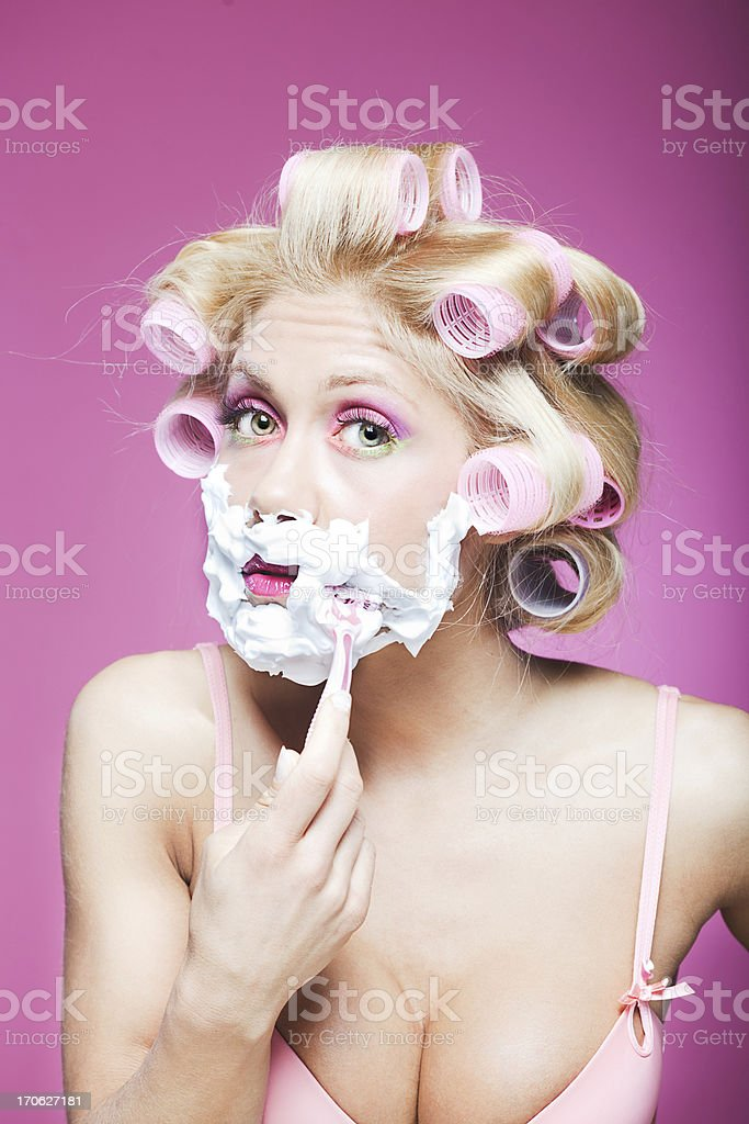 One young woman shaving in the bathroom. More files of this model and...