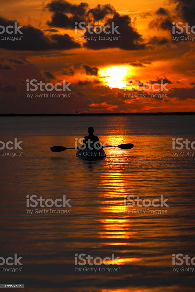 woamn in kayak enjoying Florida Keys' sunset royalty-free stock photo