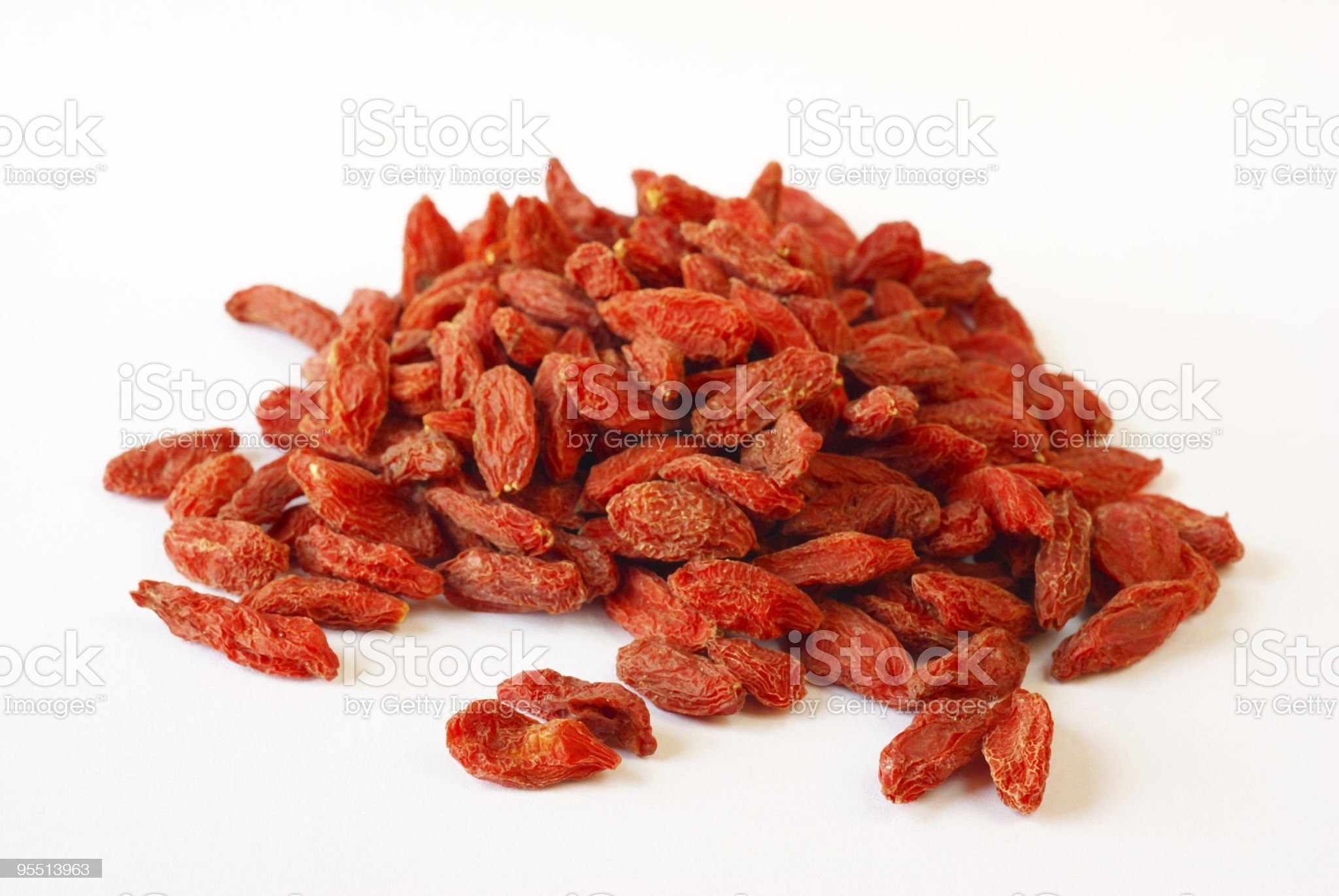 Wolf berries in a pile on white royalty-free stock photo