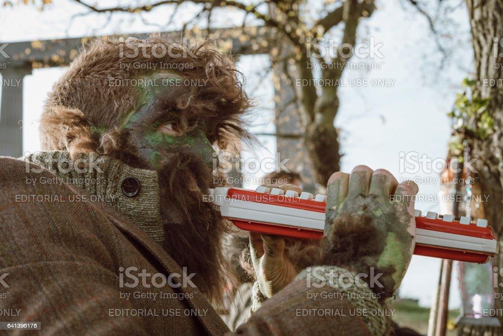Wolf Man Musician At Halloween in Edinburgh stock photo