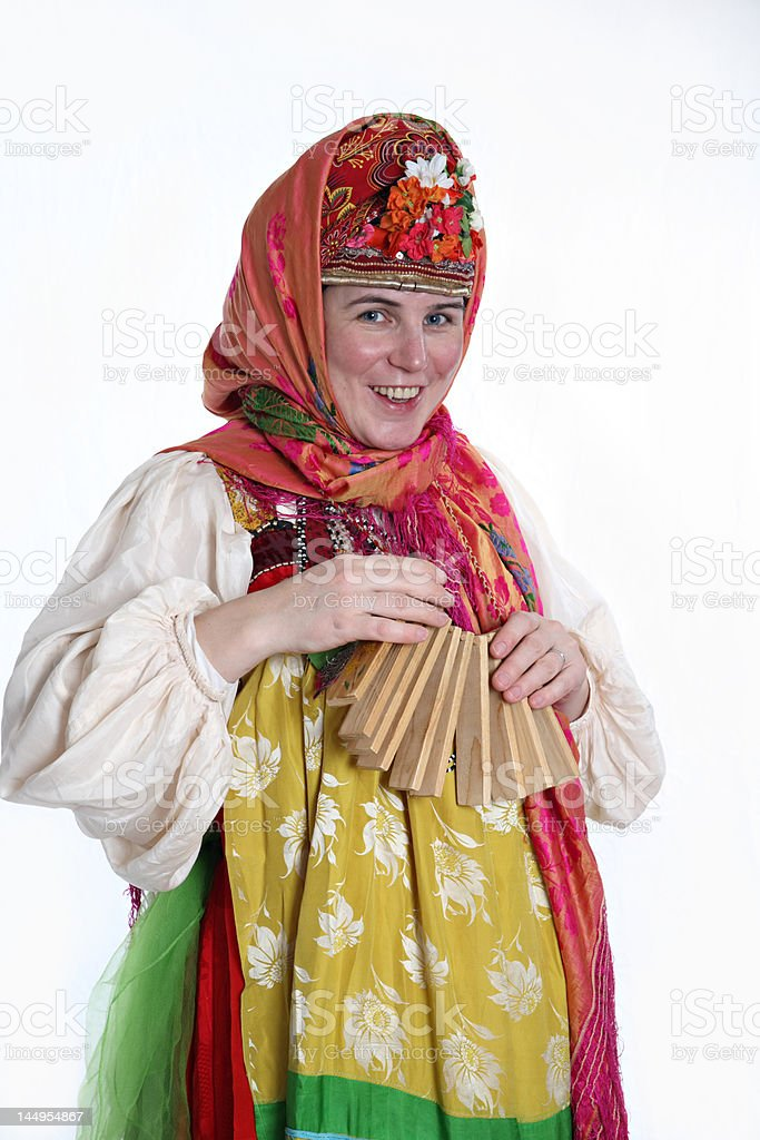 Womain in Russian clothes playing instrument stock photo