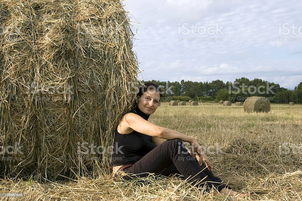 woman  about a haystack royalty-free stock photo