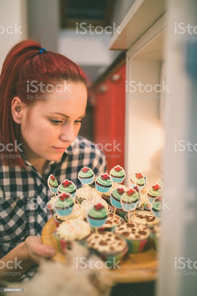 Woman about to eat delicious chocolate cupcake stock photo