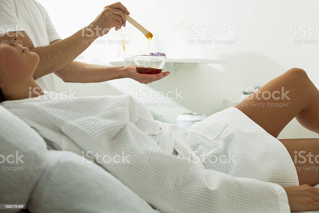 Woman About to Receive a Waxing Treatment royalty-free stock photo