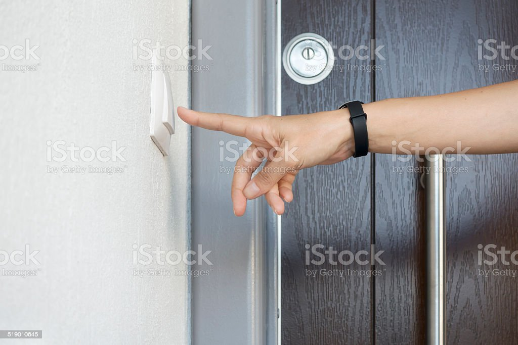 woman about to ring doorbell stock photo