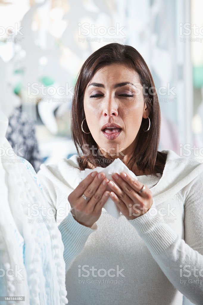 Woman about to sneeze stock photo