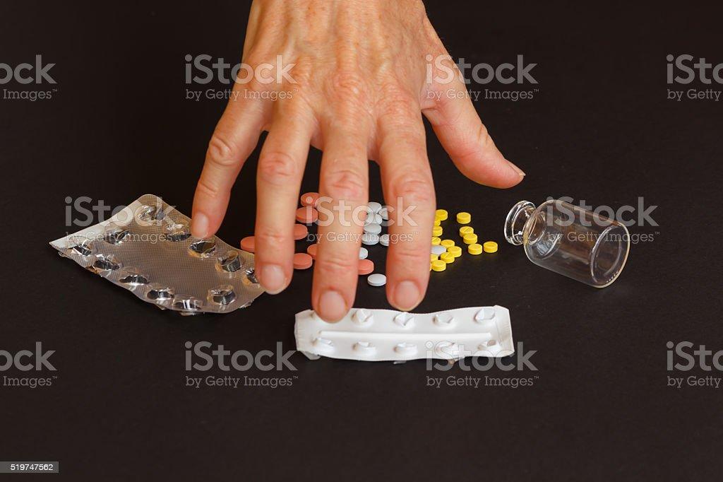 woman abusing medicines stock photo