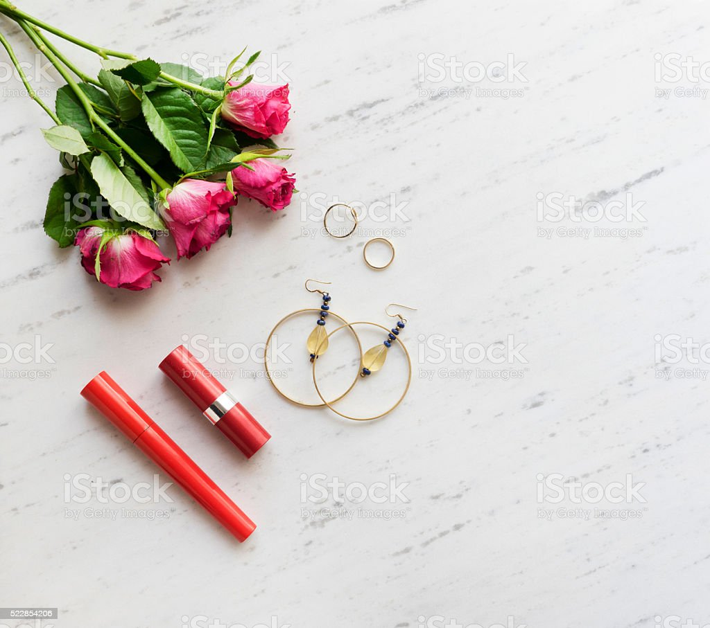 Woman accessories on white marble, stock photo
