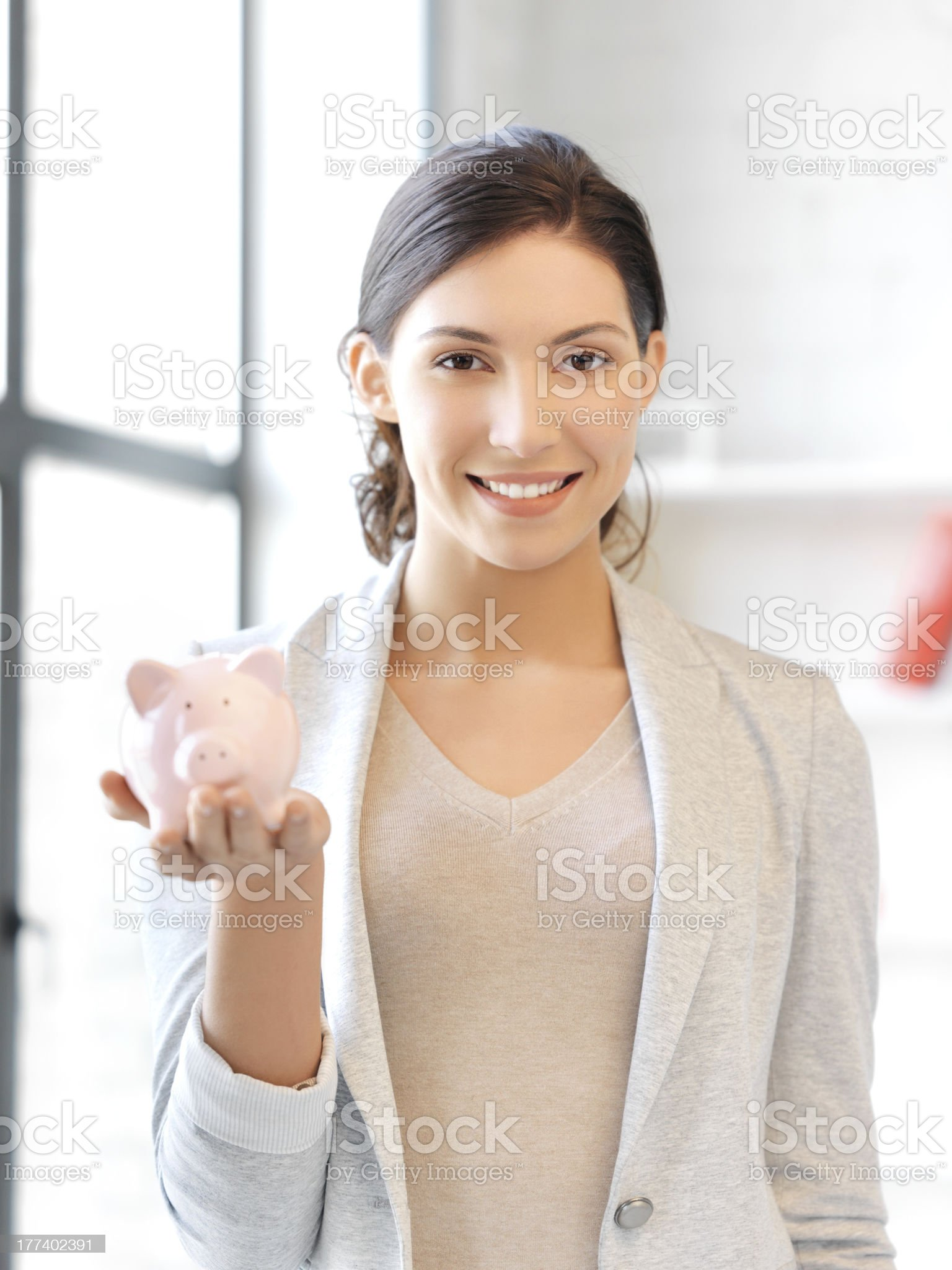 woman accountant or bookkeeper with piggy bank royalty-free stock photo