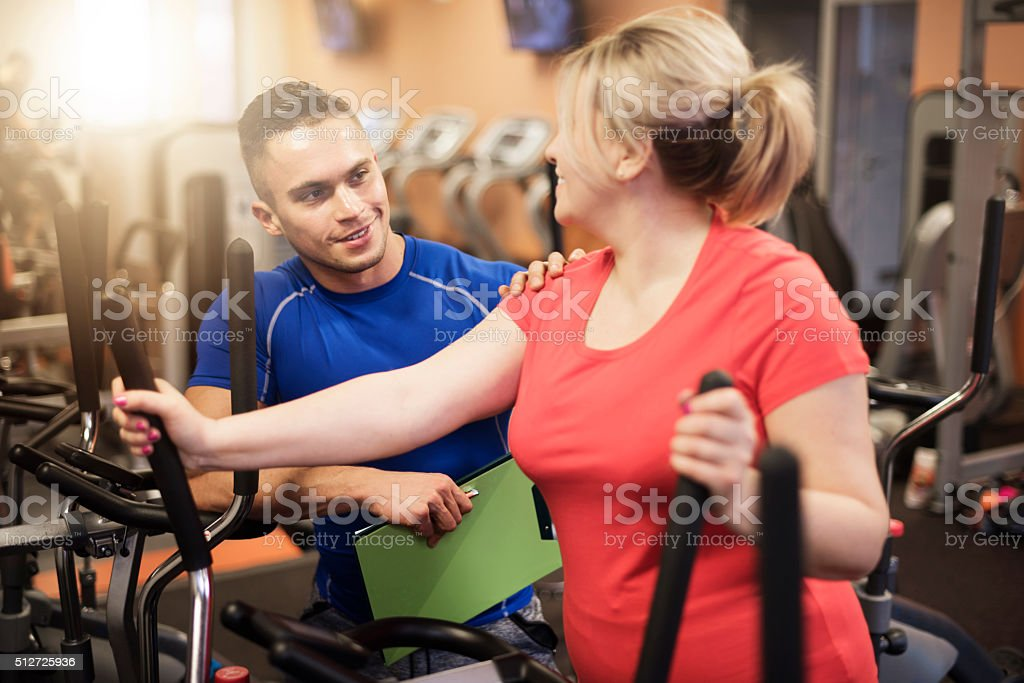 Woman achieving good results at the gym stock photo