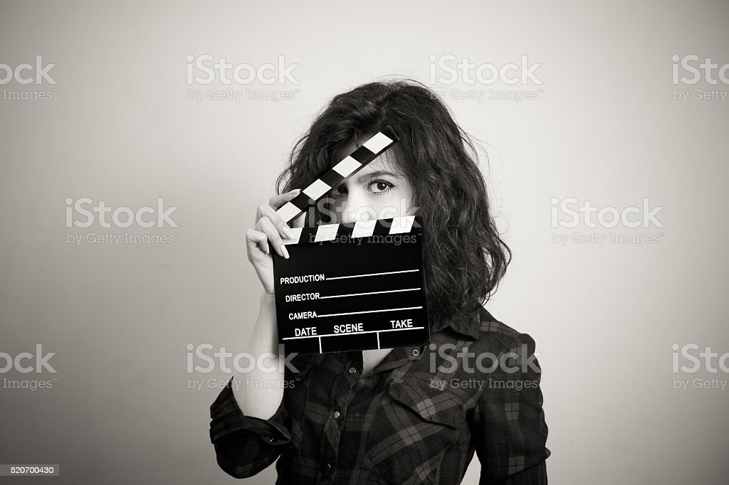 Woman actress eyes portrait behind movie clapper board stock photo