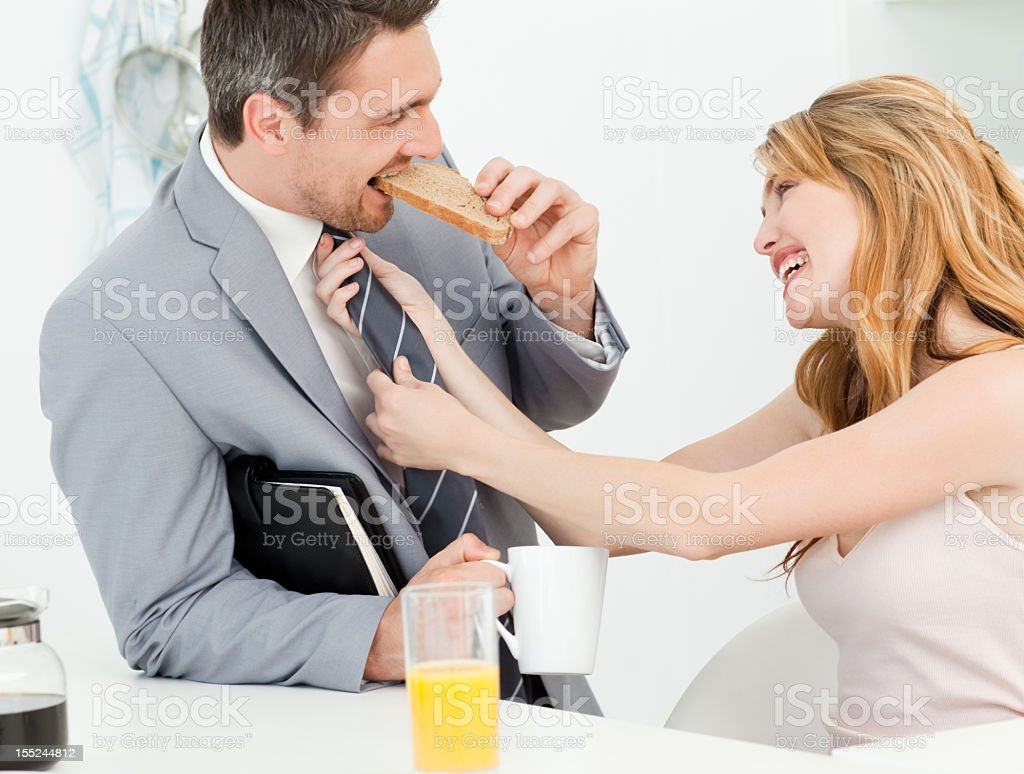 Woman adjusting the tie of her husband royalty-free stock photo