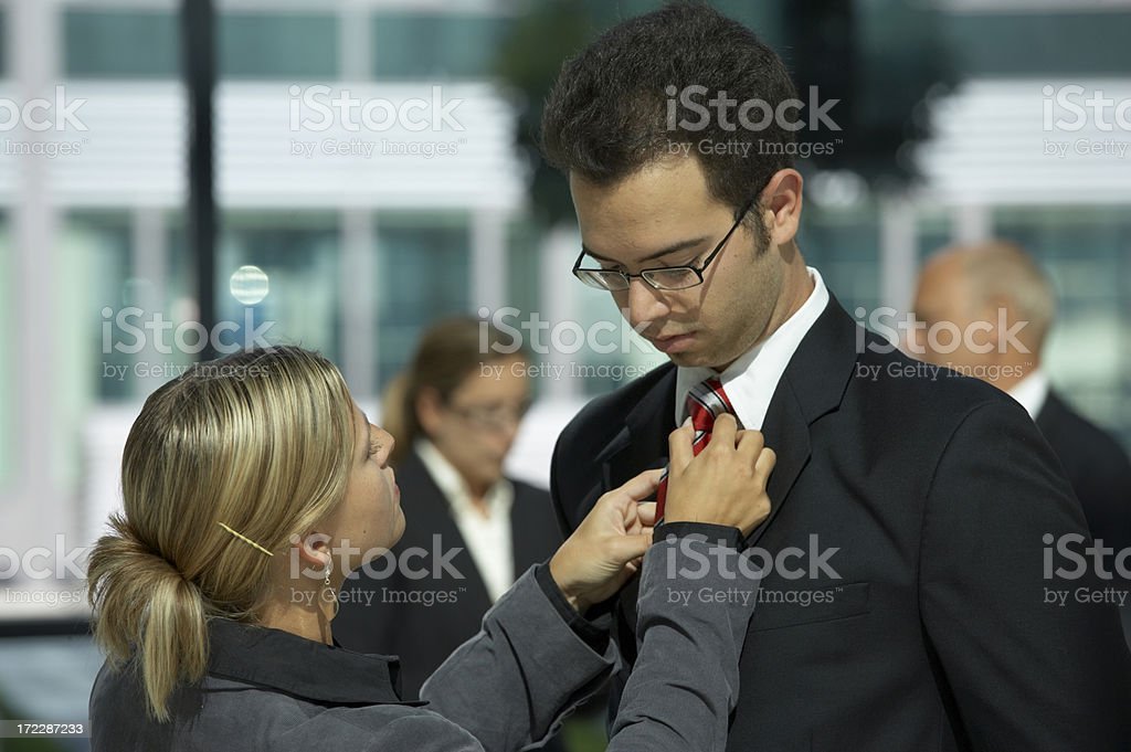 woman adjusting tie stock photo